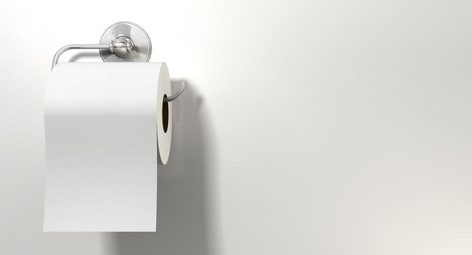 A roll of white toilet paper hanging on a chrome toilet roll holder on an isolated white textured background